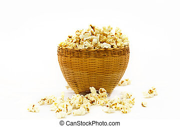 Popcorn in a wooden bucket on white background
