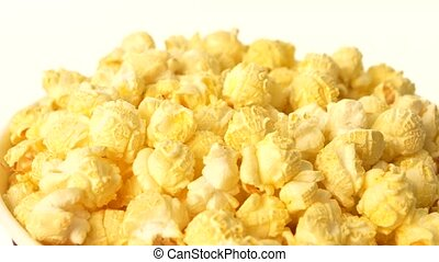 Popcorn in box on white, close up - Top of popcorn in box on...