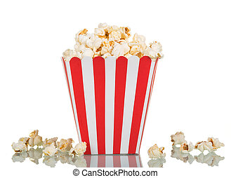 Popcorn in large square box and near isolated on white. -...
