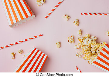 Popcorn in red and white cardboard. Top view