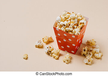 Popcorn in red and white dot paper box.
