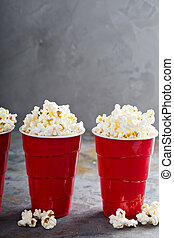 Popcorn in red cups