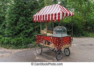 Popcorn kiosk - A nice colored kiosk selling popcorn in a ...