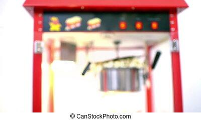 Popcorn Machine Operating - Close view of a popcorn machine...