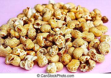 popcorn on a pink background