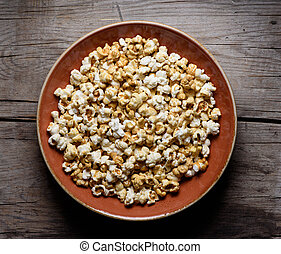 popcorn on a plate top view