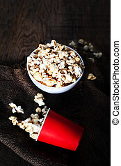 Popcorn on dark background with copyspace, cinema, movies and entertainment concept