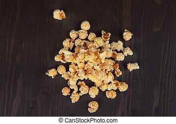 popcorn on wooden background