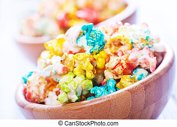 popcorn - color popcorn in bowls and on a table