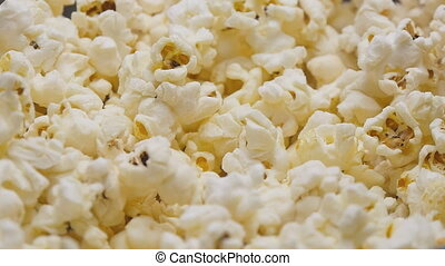 Popcorn pouring in slow motion - Salty popcorn pouring onto...