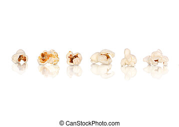 Popcorn row with reflection isolated on white background