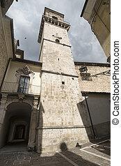 Popoli (L'Aquila, Abruzzi, Italy): historic buildings in Piazza della Liberta, the main square of the city. Belfry of the San Francesco church, 15th century