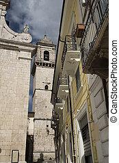 Popoli (L'Aquila, Abruzzi, Italy): historic buildings in Piazza della Liberta, the main square of the city. Facade and belfry of the San Francesco church, 15th century