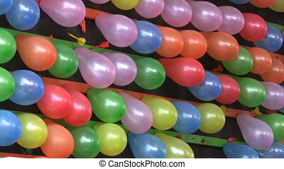Popping Balloons At A Carnival - Popping balloons at a...