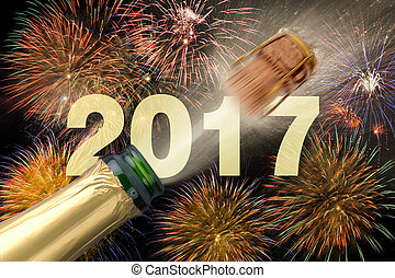 popping champagne at new years 2017