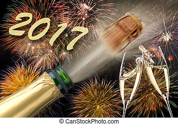 popping champagne at new years 2017 - popping champagne and...