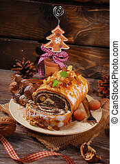 poppy seed cake for christmas on wooden table