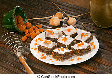 Poppy seed cake in the offering plate, decorated with orange.