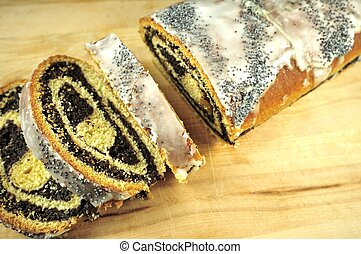 Poppy-Seed Cake on Wood Table. Food photo Collection.