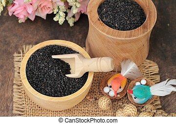 Poppy seeds of organic on wood background.