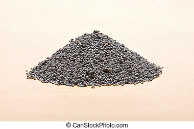 Poppy seeds on brown background