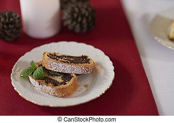 Poppyseed cake slice on the plate
