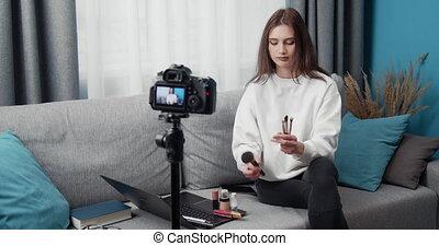 Popular beauty blogger filming tutorial on camera - Popular ...