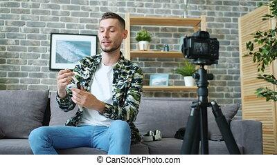 Popular blogger advertising modern watch recording video...