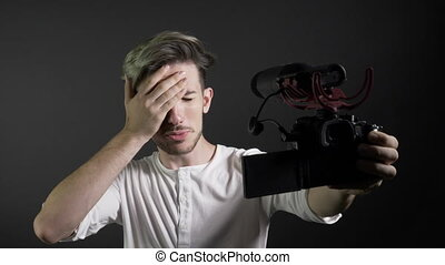 Popular social media influencer holding camera and recording...