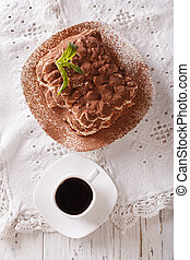 Popular Tiramisu dessert and coffee on a table close-up. vertical top view