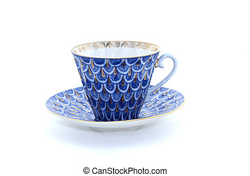 Porcelain cup and saucer on a white background