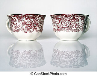 Porcelain cups - Two cups on a white reflecting surface