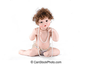 Porcelain doll with pearl beads on a white background