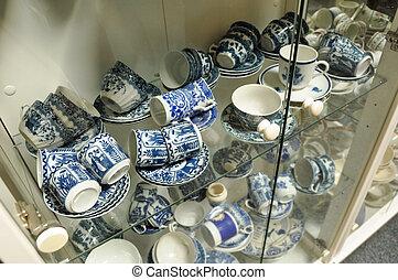 Porcelain - Glass case filled with various vintage blue ...