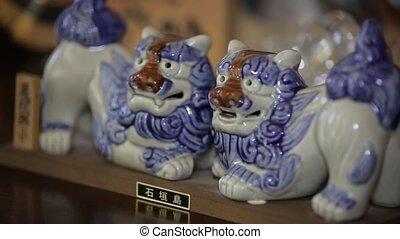 porcelain lions - Glazed porcelain lion as souvenir or gift