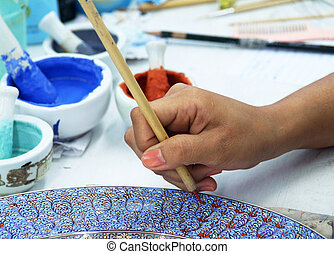Porcelain painting - Painting of porcelain by hand. A...