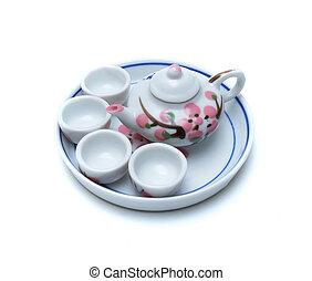 Porcelain tea pot and cup