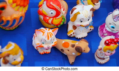 porcelain toys lie on the table during the holiday. -...