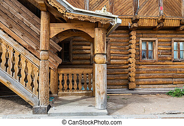 Porch at the entrance to the log house. Russian architecture