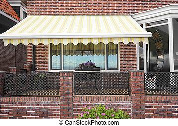 Porch brick building. - Exterior of the porch brick building...