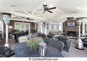 Porch in luxury home with brick fireplace