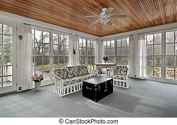 Large porch in suburban home with wood paneled ceililng