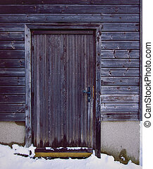Porch of old wooden house in winter