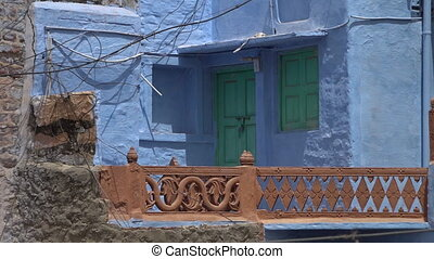 Porch on a blue house with green doors in Jodhpur - View of...