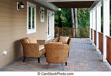Wicker furniture on deck with stone tile floor