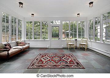 Porch in suburban home with bluestone tile