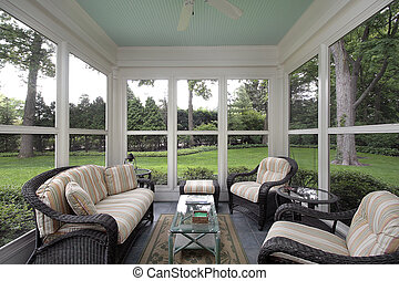 Porch with wicker furniture - Porch in suburban home with ...