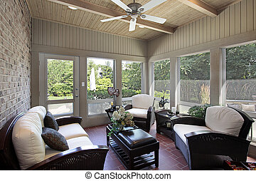 Porch in luxury home with wood ceiling beams