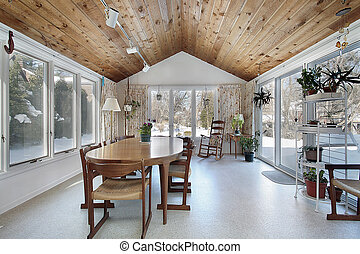 Porch in suburban home with wood ceiling