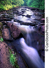 Porcupine Mountains State Park - Sunlight gleams off the...